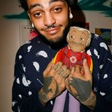 Imagem do artista Travie McCoy