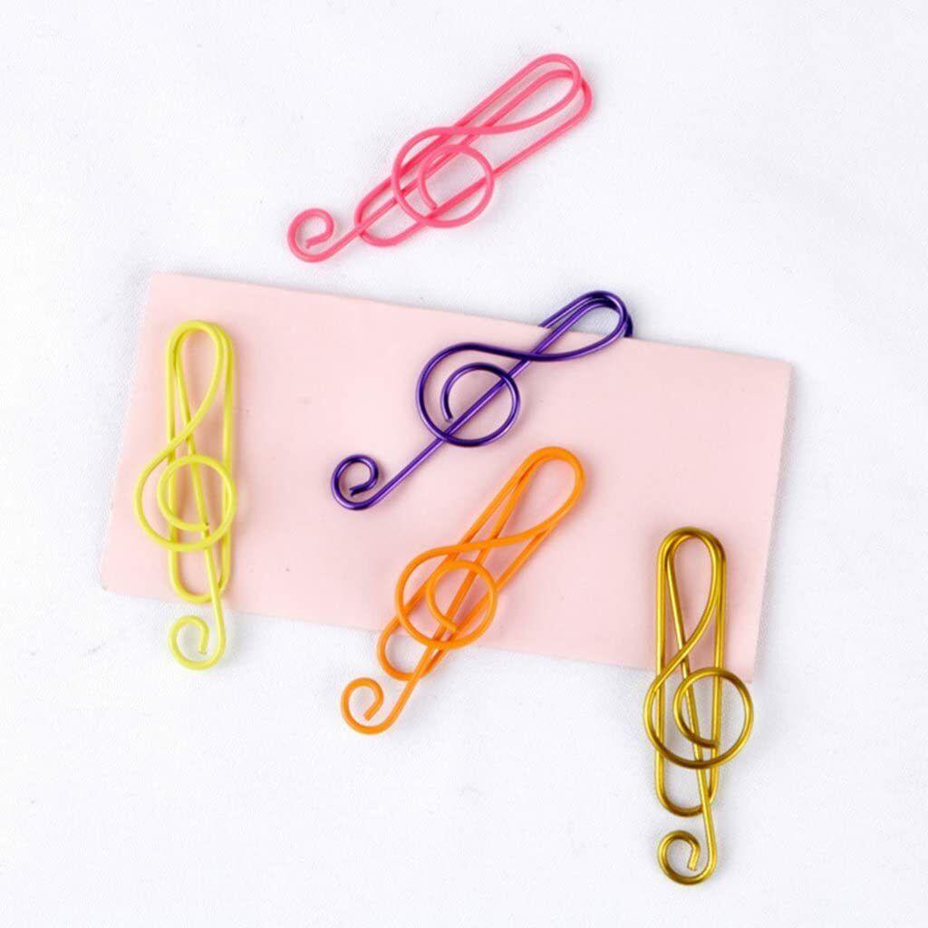 Clips de papel em formato de notas musicais